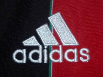 AC Milan home jersey logo