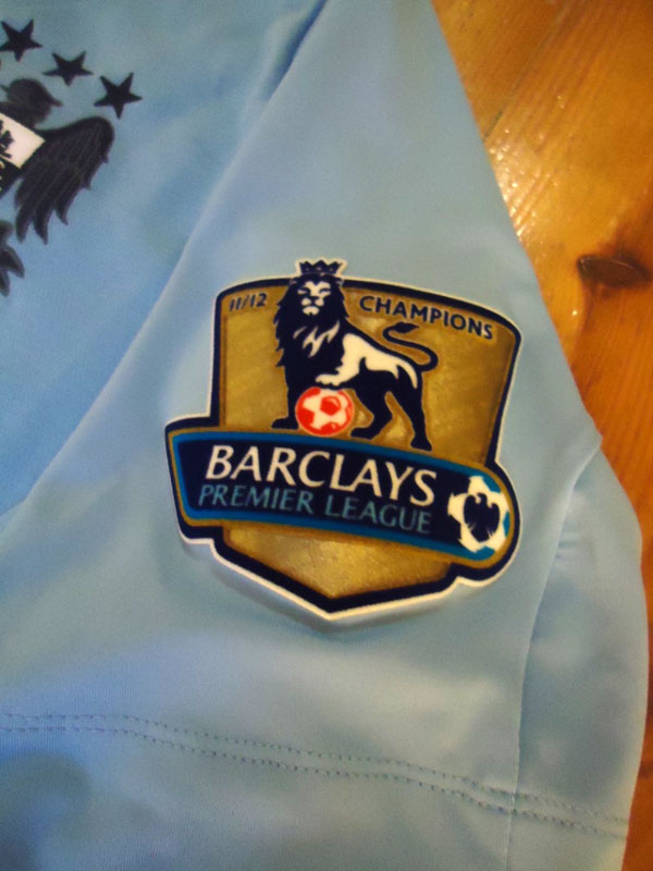 Manchester City home shirt champs badge 11-12